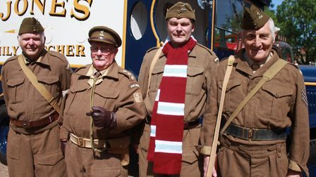 Captain Mainwaring and fellow Walmington-on-sea Home Guard members pose for a photo in front of Jone