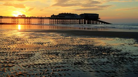 Cromer Pier and beach bathed in evening sunshine. Picture: Peter Jarvis
