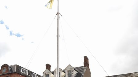 The East of England Co-op Funeral Services raise a flag to commemorate those who lost their lives in