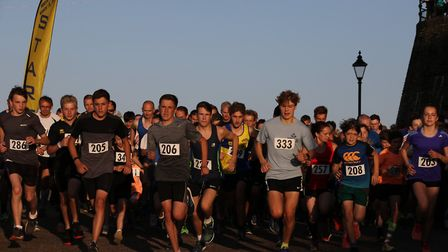 Competitors put their best foot forward at the start of the Cromer Carnival fun run. Picture: Ally M