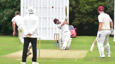 Jordan Taylor on his way to a century for Swardeston against Great Witchingham. Picture: Nick Butche