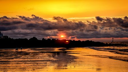 Beautiful sunset at Sheringham reflected in the wet sand. Picture: Richard Brunton