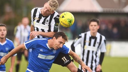Action from Dereham Town's FA Cup clash against Boston United. Picture: Ian Burt