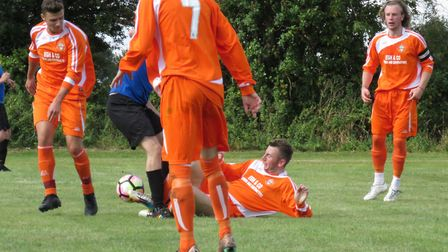 Trimingham's George Crane tussles for the ball watched by Liam Amos ( 7) and scorers Jordan Tipple a