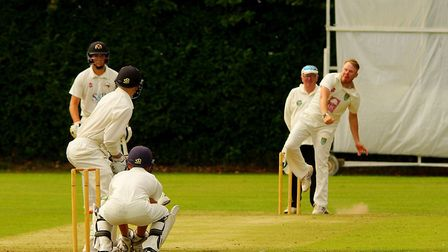 Mike Jones delivers for Great Witchingham during their win over Vauxhall Mallards at Halvergate. Pic