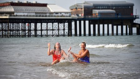 Wendy Manning and her daughter Clemmie from Cley enjoying the sea and sunshine at Cromer beach.Pictu