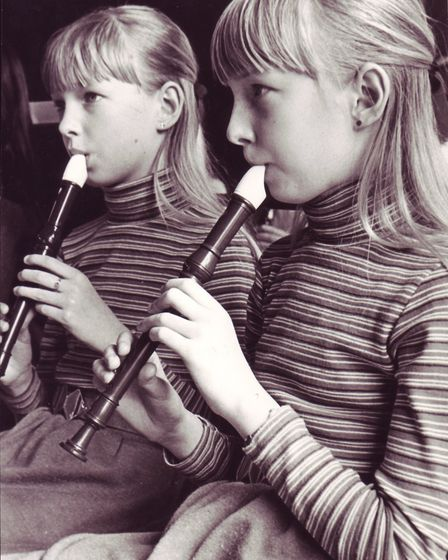 Twins Deborah (left) and Monica Gibbons (right), aged 11, from Cromer Junior School playing their re