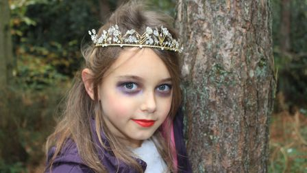 Spooky bride Izzie, 9, on the hunt for witch's brew ingredients at a Halloween trail held at Holt Co