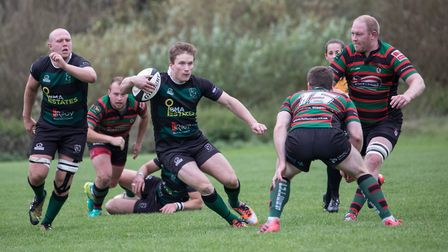 Dan Smith beats his man as North Walsham take on Watford side Fullerians. Picture: Hywel Jones