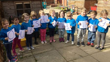 Youngsters at Worstead Pre-School celebrate the setting's 'outstanding' Ofsted grading. Photo: WORST