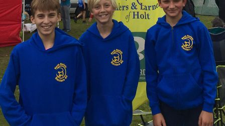 Innes O'Malley, Brad Keay and Henry Jonas are all smiles after their superb performance in the Engli