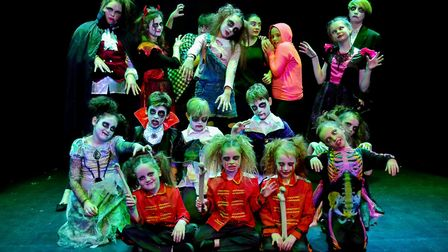 Budding young stage stars dressed in spooky style at a Halloween-themed musical theatre workshop hel