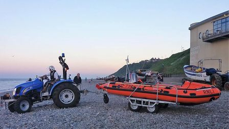 Cromer lifeboat returning to shore after being called to the aid of a swimmer. Photo: PAUL RUSSELL