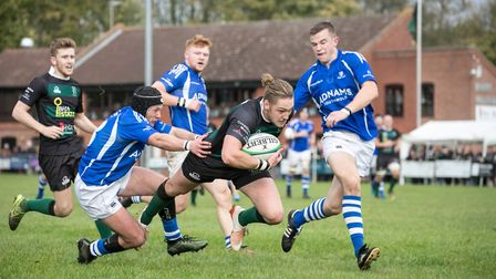 Hal Riley in full flight for North Walsham during Saturday's derby win over Diss at Scottow. Picture
