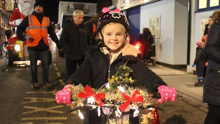 Eight-year-old Lila on her decorated bike at last year's Sheringham Christmas lights festival. Photo