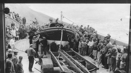 Holidaymakers crowd round as Sheringham lifeboat comes back after its Lifeboat Day launch, August 19