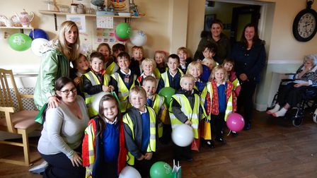 Youngsters, staff and parents at Hickling School who took part in a memory walk to help raise money