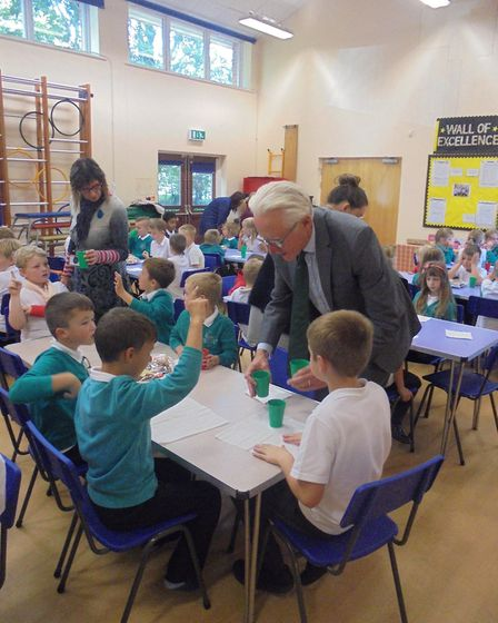 North Norfolk MP Norman Lamb talks to youngsters at Catfield School who took part in a memory walk t