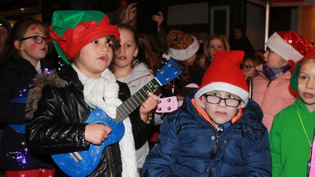 Sheringham Primary School choir and ukulele group performing at the town's Christmas lights switch-o