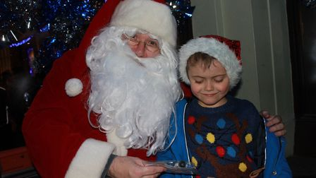 Seven-year-old Sam meets Santa at Sheringham Christmas lights switch-on. Photo: KAREN BETHELL