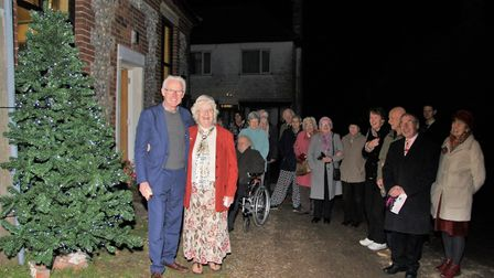 Norman Lamb with Ros Peedle and congregation, switching on the Christmas tree lights. Picture: Mauri