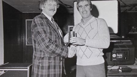 Sheringham town councillor Mac McGinn (left) being presented with an award for services to football