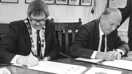 Long-serving Sheringham town councillor Mac McGinn signing the twinning charter in 1983 with Otternd
