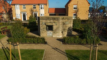 The pillbox as centrepiece of memorial garden. Picture: Mike Sewell