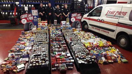 Flashback to last year's event. STS Tyre pro staff with the collection for Norwich foodbank. Picture