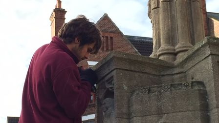 Work has started on a project to restore Cromer war memorial. Alex Rickett removing the figures from
