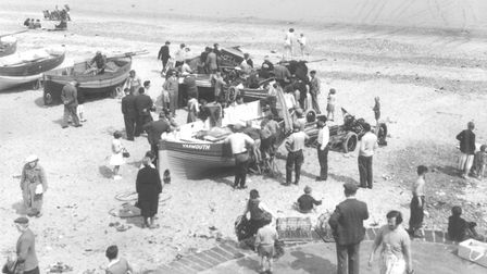 Places CWhit Monday holiday trippers at Cromer looking at the fishing fleetDated -- May 21st 1956Ph