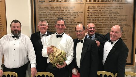 BBC rugby commentator Ian Robertson (third from left) and Holt RFC officials with the auctioned suga