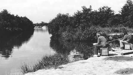 Places - SThe river at Stalham with anglers peacefully fishing.Dated August 1974Photograph C8635