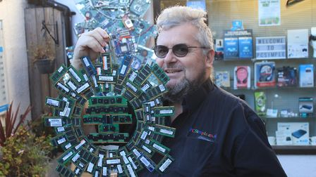 Sheringham computer shop owner Clive Sanham with his technology-inspired Christmas tree and wreath.