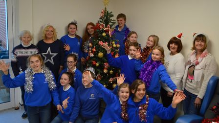 Broadland Youth Choir and members of the League of Friends before the carol singing at North Walsham
