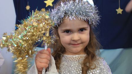 Sadie, 3, as a Christmas star in the Ladybird Pre-school Nursery production of Our First Nativity. P
