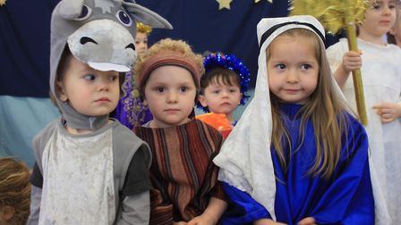Three-year-olds Francesca and Chobi as Mary and Joseph with Zak, also three, as a donkey in the Ladb