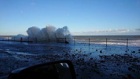 A wave thumps into Cromer prom. Photo: Amanda West