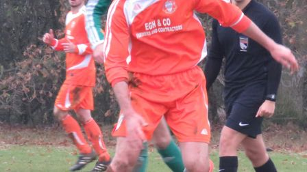 Trimingham Pilgrims' Dan Gabriel on the ball at the weekend, with Lewis Amos watching on. Picture: C