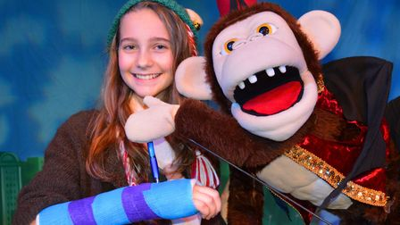 Twelve-year-old Ayrelia O'Leary-Leeson has has her cast signed by Sheringham Little Theatre panto st