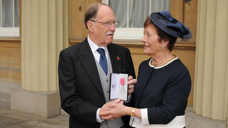 Robin Rush received his MBE at Buckingham Palace. With his wife Eileen. Copyright: PA Photos