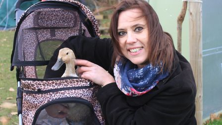 Sheringham Primary School teaching assistant Lisa Heir with Sheldon the duck, who, with her best fri