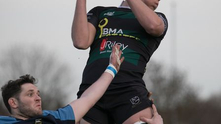 Ryan Oakes collects the ball at a line-out for North Walsham during their 41-21 defeat at Eton Manor
