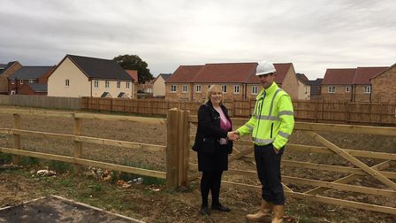 PICTURED: Josh Ford, contracts manager at Persimmon Homes Anglia, hands over allotments to Sue Lake,