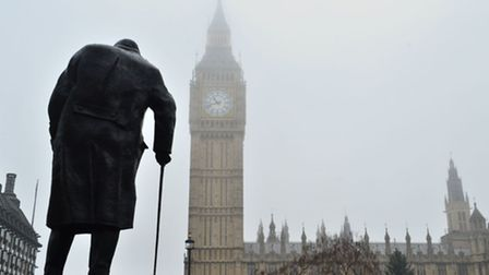 The statue of Winston Churchill in Parliament Square and the Houses of Parliament