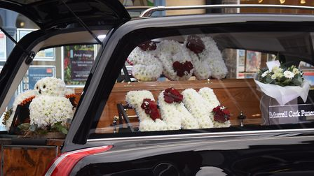 Flowers for Ian Tang in the hearse for his funeral at St Nicholas Church in North Walsham. Picture: