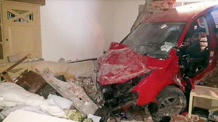 Car crashes through house in Weybourne. Pictures: Supplied by Thomas Clayton