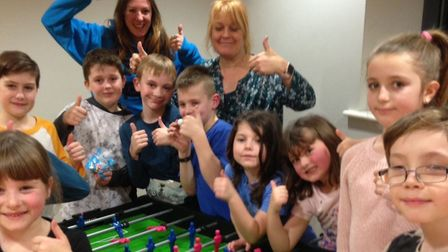 Youngsters from Sheringham Youth Zone with Lara Nicole and Julie Chalmers. Picture: