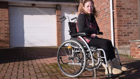 Julie Potter on her empty driveway at North Walsham after having her mobility car taken away. Pictur