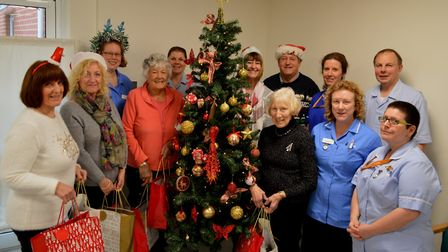 North Walsham War Memorial Hospital's Friends meet with nursing staff before handing out festive gif
